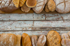Variety of breads arranged on wooden plank Stock Photography