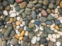 A variety of bright colored pebbles stock photos