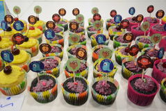 Variety of brightly decorated cupcakes Royalty Free Stock Photography