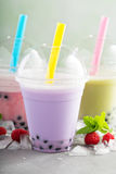 Variety of bubble tea in plastic cups royalty free stock photos