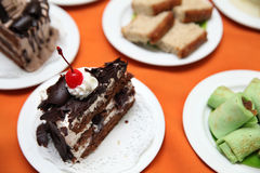 Variety of cakes. On white plate at buffet dessert Stock Photo