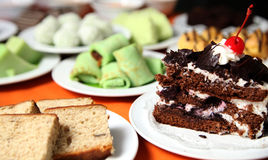 Variety of cakes. On white plate at buffet dessert Royalty Free Stock Images