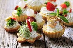 Variety of canapes. Variety of pastry-based canapes with various toppings Royalty Free Stock Photo