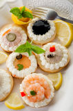 Variety of canapes on dish Stock Image