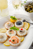 Variety of canapes on dish Stock Images