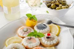Variety of canapes on dish Stock Photos