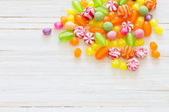 Variety of candies on  wooden background Stock Photography