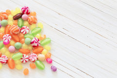 Variety of candies on  wooden background Stock Photos
