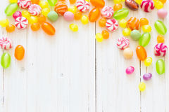 Variety of candies on wooden background Royalty Free Stock Images