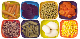 Variety of Canned Vegetables in Colorful Bowls Royalty Free Stock Photos