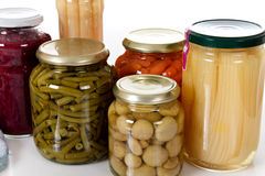 Variety of canned vegetables in jars. Stock Images