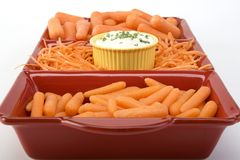 Variety of carrots with dip in a square ceramic di