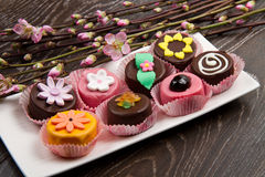Variety of cassate sicily dessert with spring flower on wood Royalty Free Stock Photo