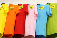 Variety of casual clothes in shop stock photography