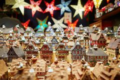 Variety of ceramic houses and star garlands at traditional Christmas market in Strasbourg stock image