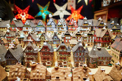 Variety of ceramic houses and star garlands at traditional Christmas market in Strasbourg. Alsace, France Royalty Free Stock Images