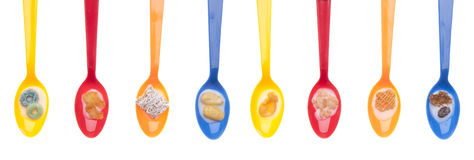 Variety of Cereals in Vibrant Spoons with Milk Stock Photography