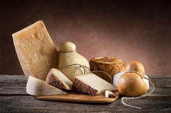 Variety of cheese. On wood background Royalty Free Stock Image
