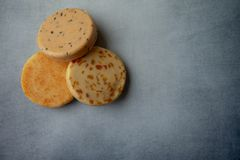 Variety of cheese on a blue background. With copy space royalty free stock image