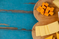 Variety of cheese on chopping board Stock Photography