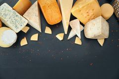 Variety of cheese. On dark background Stock Images
