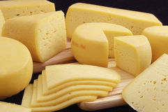 Variety of cheese. Laminae and pieces of delicious and healthy cheese stock image