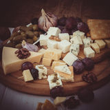Variety of cheese with nuts and olives Royalty Free Stock Photo