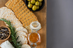 Variety of cheese with olives, honey, rosemary, walnuts and crackers Royalty Free Stock Photography