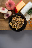 Variety of cheese with peach, honey, rosemary, walnuts and crackers Stock Photography