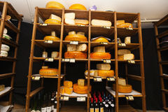 Variety of cheese in shelves at store Royalty Free Stock Image