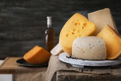 Variety of cheese. On table Stock Images