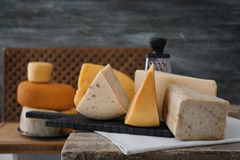 Variety of cheese. On table Royalty Free Stock Images