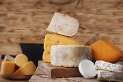 Variety of cheese. On table Royalty Free Stock Image