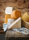 Variety of cheese. On table Stock Photos