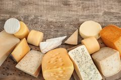 Variety of cheese. On wooden background Royalty Free Stock Photography