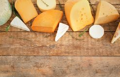 Variety of cheese. On wooden background Royalty Free Stock Photos