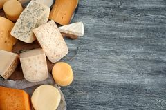 Variety of cheese. On wooden background Royalty Free Stock Image