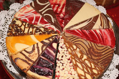Variety cheesecakes. Slices of different varieties of cheesecakes on a platter Stock Images