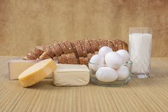 Variety Of Cheeses, Bread, Milk And Eggs Royalty Free Stock Photography
