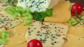Variety of cheeses on a cutting board stock footage