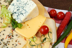 Variety of cheeses on a cutting board Stock Image