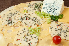 Variety of cheeses on a cutting board Royalty Free Stock Photo
