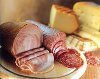Variety of cheeses, salami and bacon. Stock Images