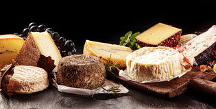Variety of Cheeses on Table with Dark Background royalty free stock photography