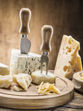 Variety of cheeses. Vintage stiles. Stock Photos