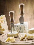 Variety of cheeses. Vintage stiles. Royalty Free Stock Photos