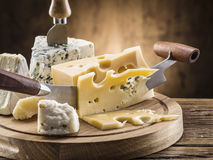 Variety of cheeses. Vintage stiles. Royalty Free Stock Image