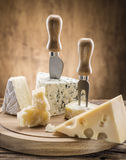 Variety of cheeses. Vintage stiles. Royalty Free Stock Photo