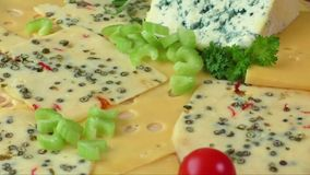 Variety of cheeses on a wooden board stock video