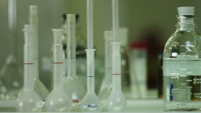 A variety of chemical glassware with colored liquids stock video